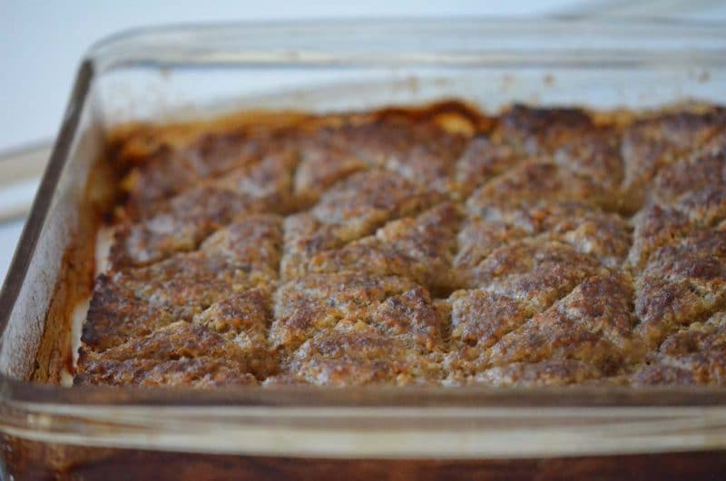 Baked kibbeh in a glass baking dish, cut in decorative squares, Maureen Abood