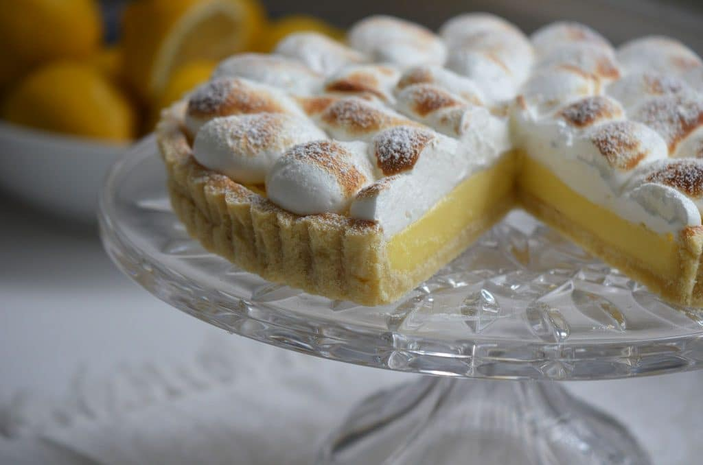 Lemon meringue tart on a footed crystal plate