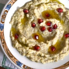 Baba Gannouj on a plate with pomegranate seeds
