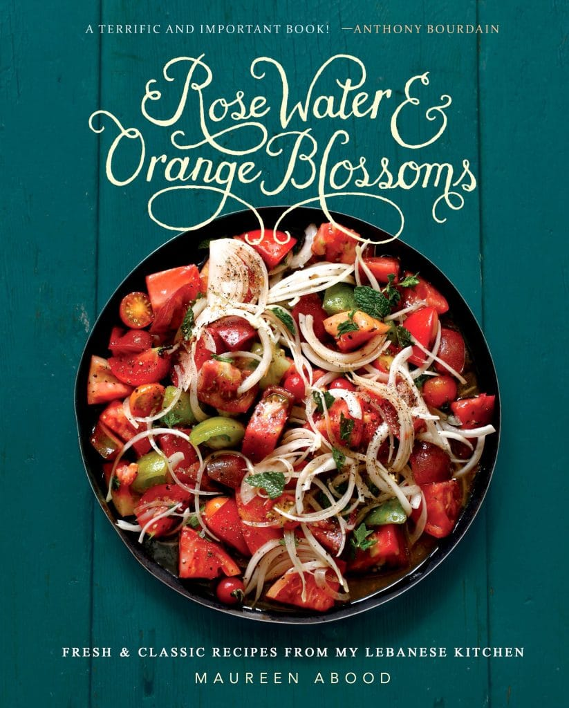 Tomato salad on a green background on the cover of the Rose Water & Orange Blossoms cookbook