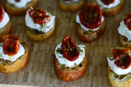 Zaatar roasted tomato crostini with labneh, on a board, MaureenAbood.com