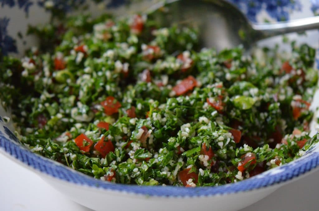 Tabbouleh salad with bulgur and tomatoes in a blue-rimmed bowl, Maureen Abood