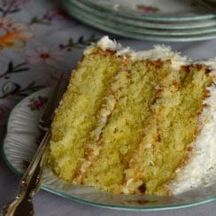 Triple layer coconut cake slice with a fork