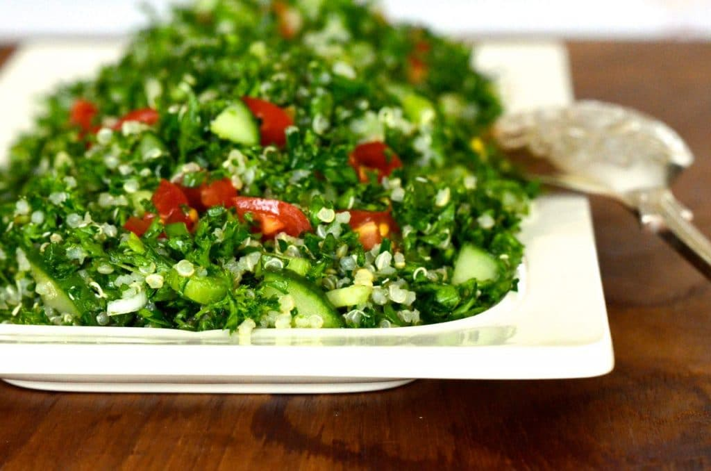 Quinoia tabbouleh with mint, onion, tomato, and parsley on a white platter, MaureenAbood.com