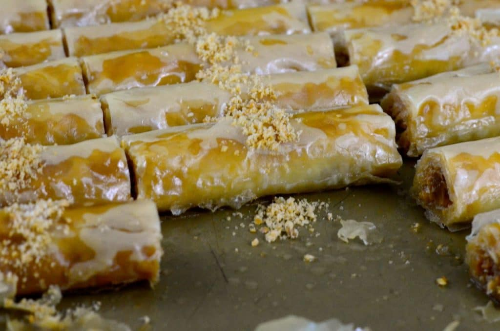 Almond baklawa fingers in a pan, Maureen Abood