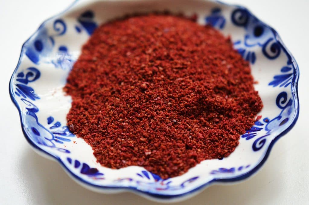 Sumac spice in a blue bowl