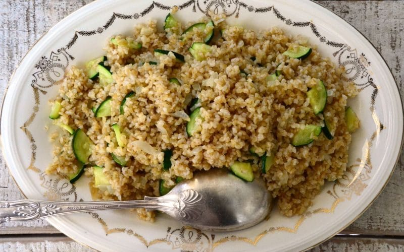 Toasted Bulgur pilaf platter with a spoon