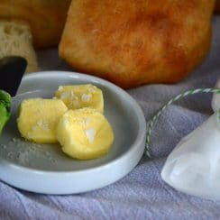 Homemade cultured butter with a green knife