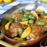 Chicken with lemon and olives in a copper baking dish