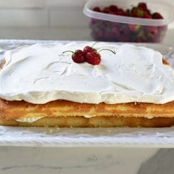 Strawberry cream cake with whipped cream and topped with berries