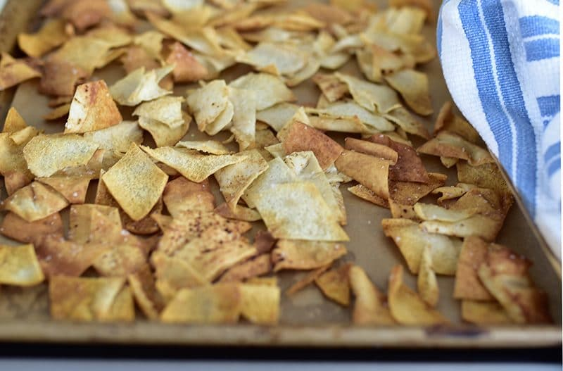 Baked pita chips on a sheet pan