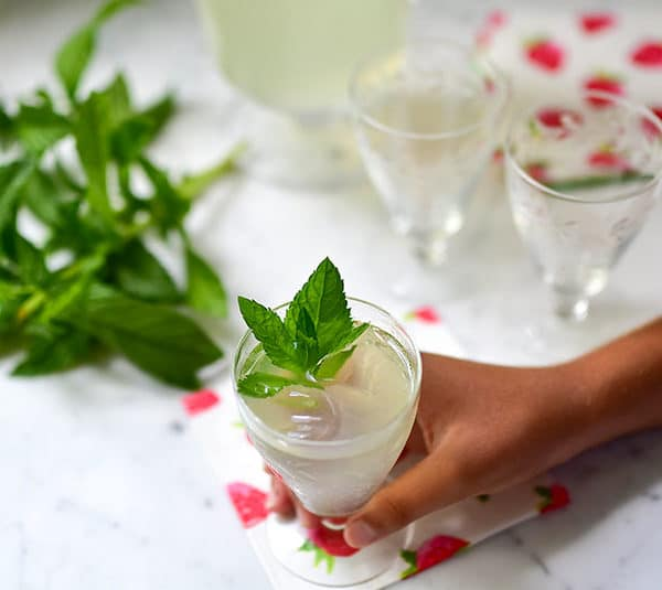 Fresh mint lemonade with mint sprigs and little hand, Maureen Abood.com