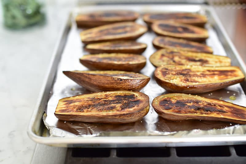 Broiled eggplant halves on a foil-lined sheet pan, Maureen Abood