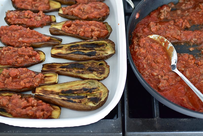 Eggplant boats in a white casserole filled with tomato meat sauce, Maureen Abood
