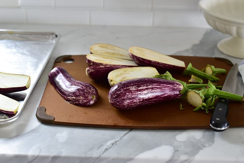 Sliced eggplant on a board with a knife, Maureen Abood