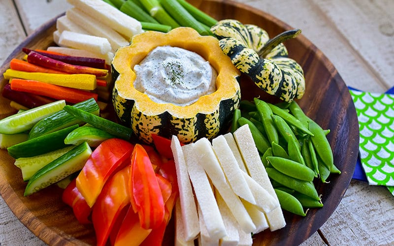 Labneh dip in a squash bowl with vegetables