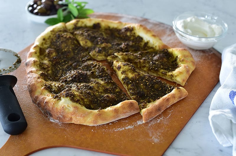 Za'atar flatbread on a pizza peel, Maureen Abood
