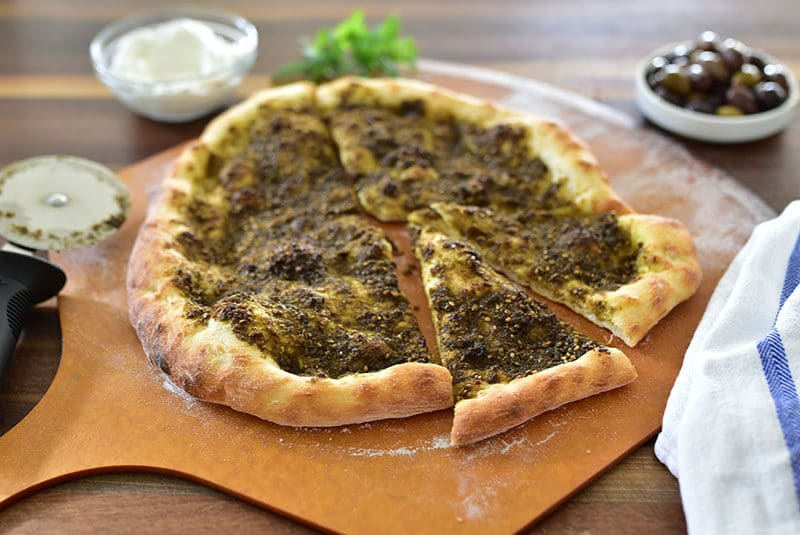 Zaatar flatbread on a pizza peel
