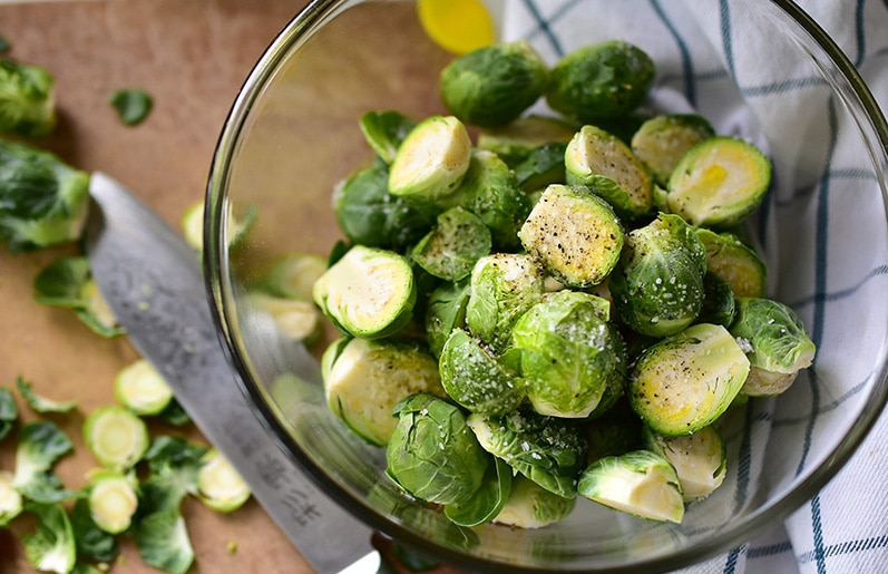 Seasoned brussels sprouts in a glass bowl, MaureenAbood.com