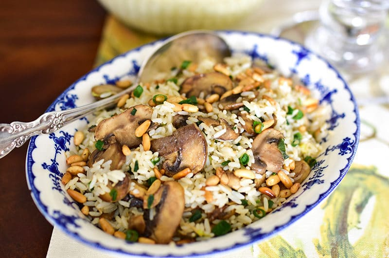 Lebanese rice with pine nuts and mushrooms in a blue bowl