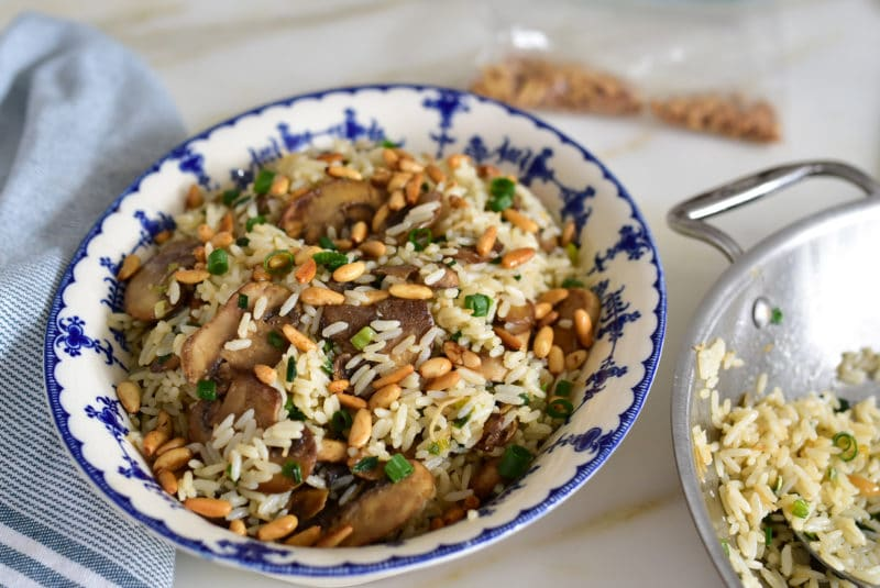 Mushroom and cinnamon rice garnished with toasted pine nuts