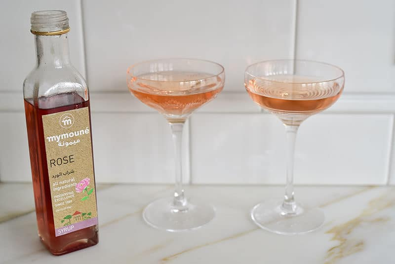 Rose Champagne Cocktail with Rose Syrup in coupe glasses, Maureen Abood.com