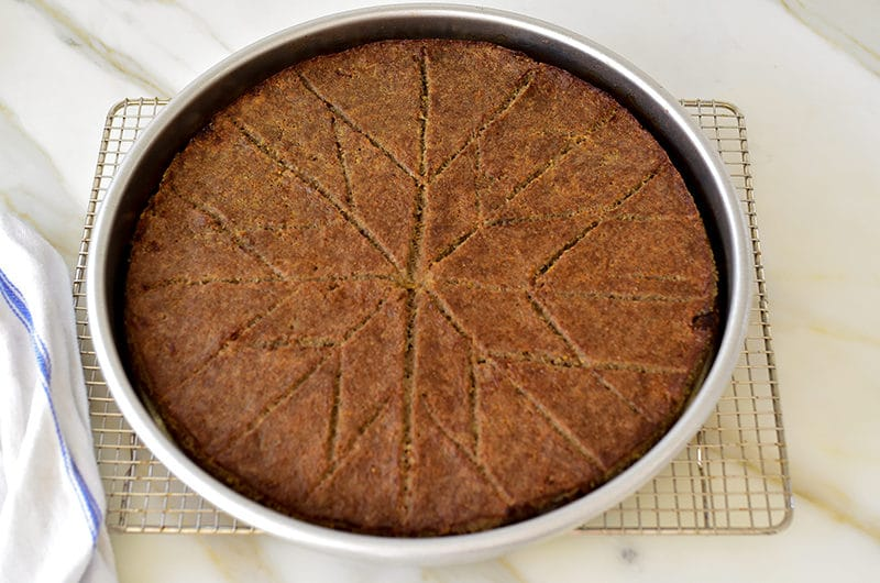 Kibbeh sahnieh in a round pan, cut in diamonds