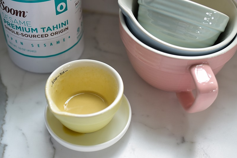 Tahini in small measuring cups
