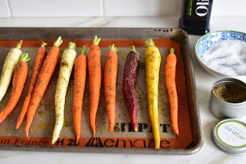 Carrots coated with za'atar on a sheet pan