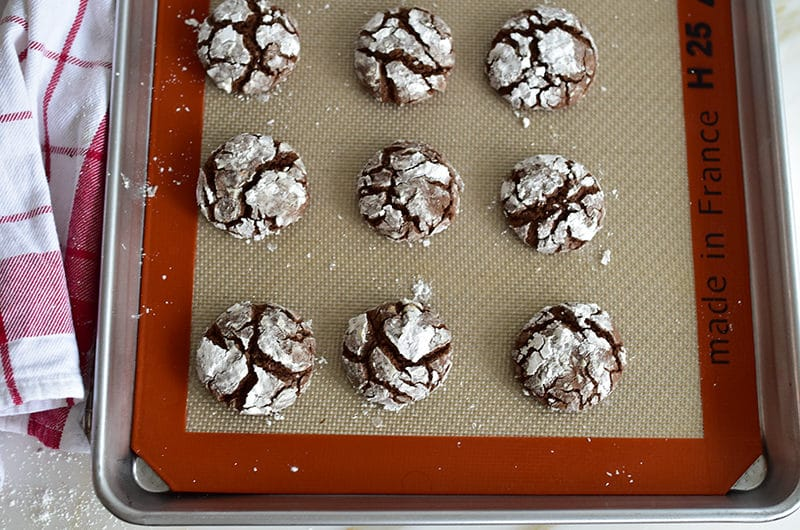 Chocolate crinkle cookies with orange blossom on a silpat
