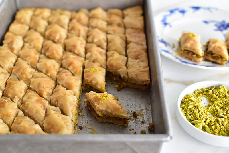 Pistachio baklawa made with olive oil, cut in pieces in the pan