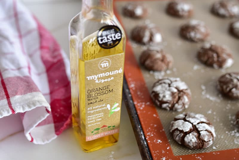 Chocolate crinkle cookies with bottle of Mymoune orange blossom water