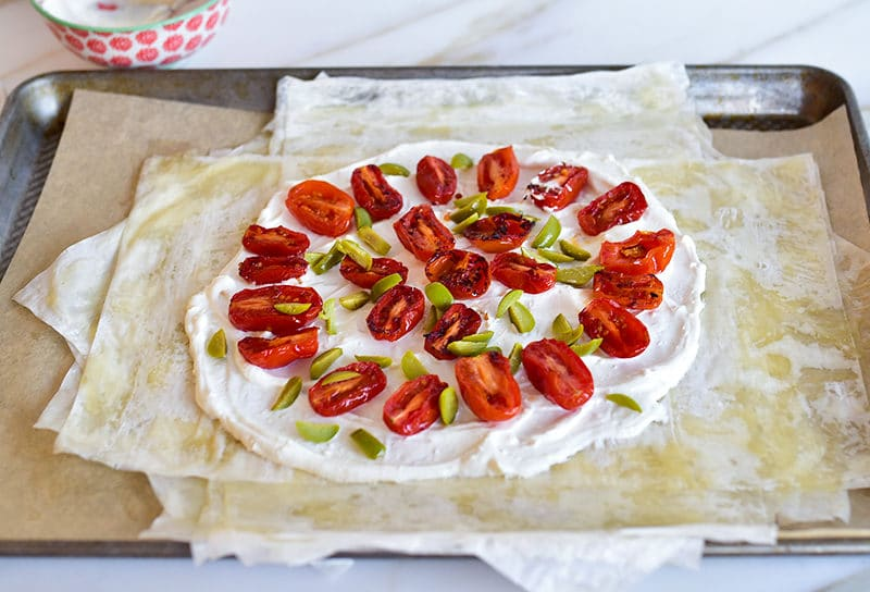 Tomatoes and olives atop phyllo for savory phyllo galette
