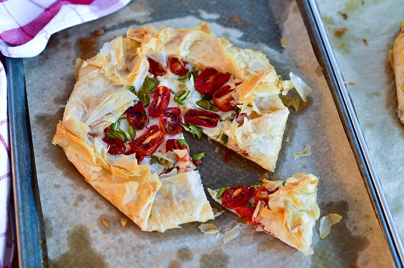 Savory Phyllo Galette on a sheet pan with a slice cut
