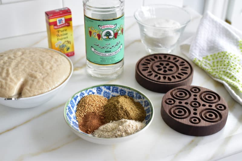 Arak, molds, spices on the counter for ka'ik Easter cookies