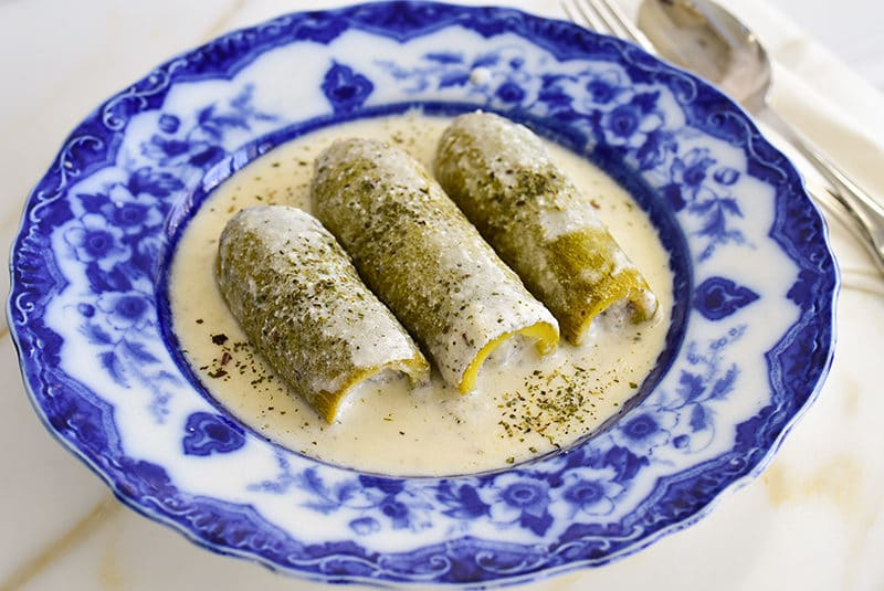 Koosa cooked in yogurt sauce and served in a blue dish