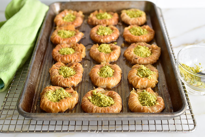 Pistachio baklava nests on a sheet pan