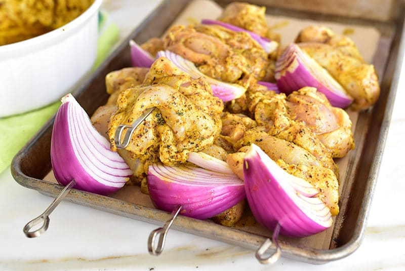 Marinated chicken and onion on skewers for shawarma