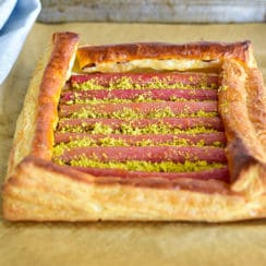 Rhubarb tart with pistachios on a sheet pan