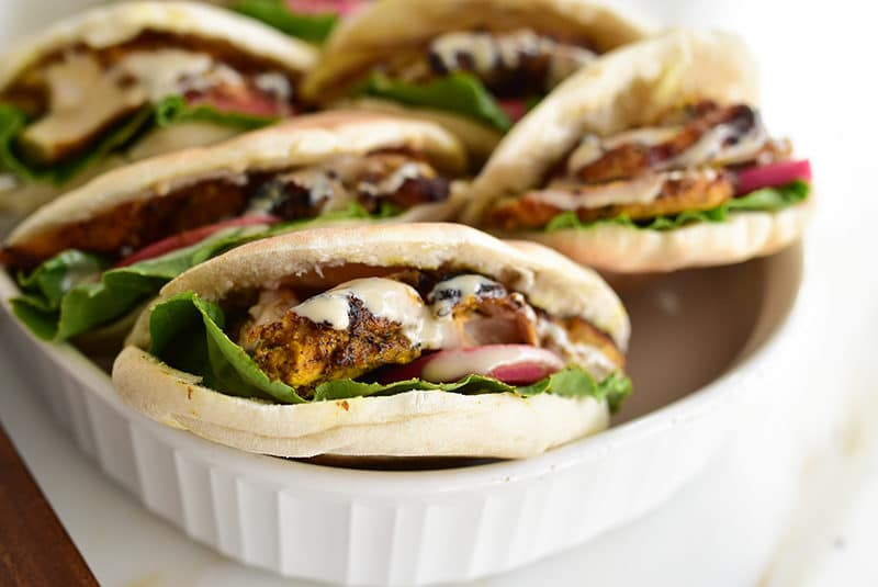 Grilled chicken shawarma pitas with tahini sauce