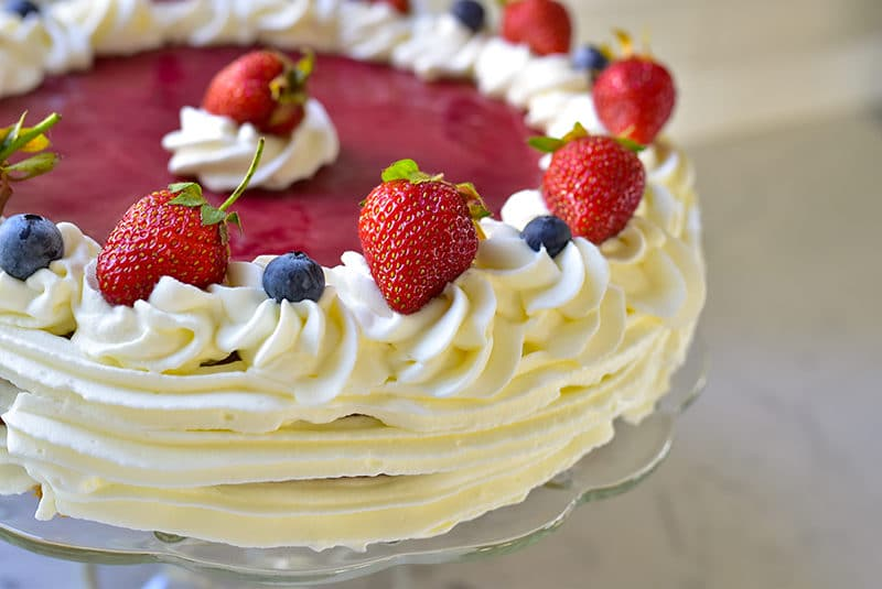 Whipped Cream piped on a strawberry cake