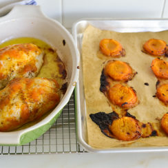 Apricot chicken in a roasting pan with roasted apricots