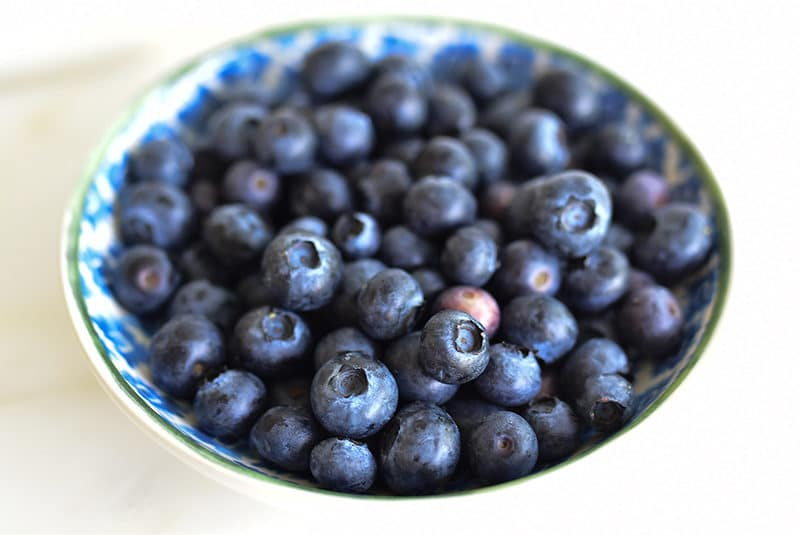 Blueberries in a green and blue dish