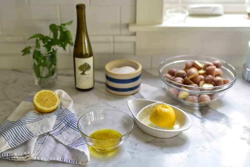 Lemon and olive oil on the counter with salt and mint