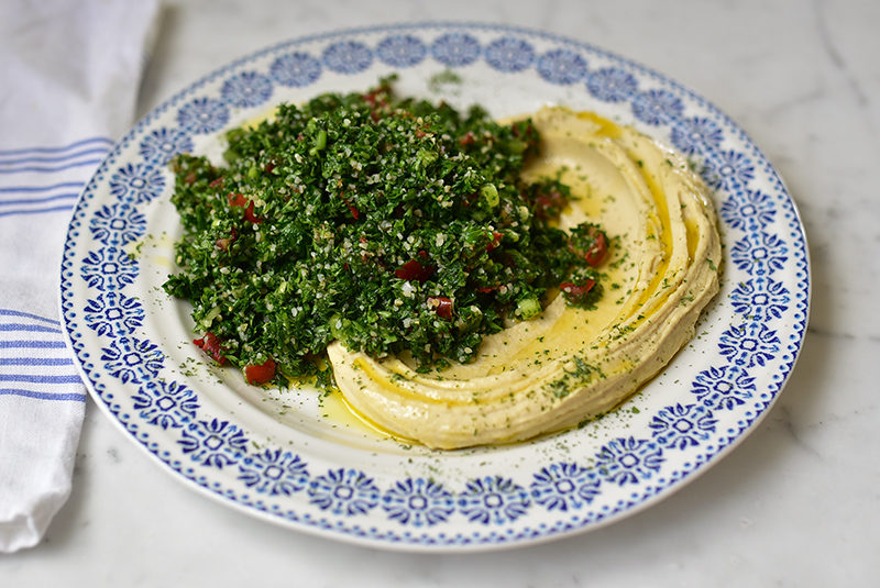 Tabbouleh Hummus Platter with blue and white platter
