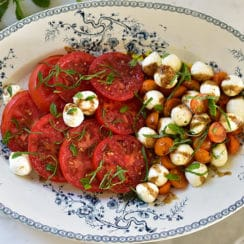 Caprese salad on a blue platter