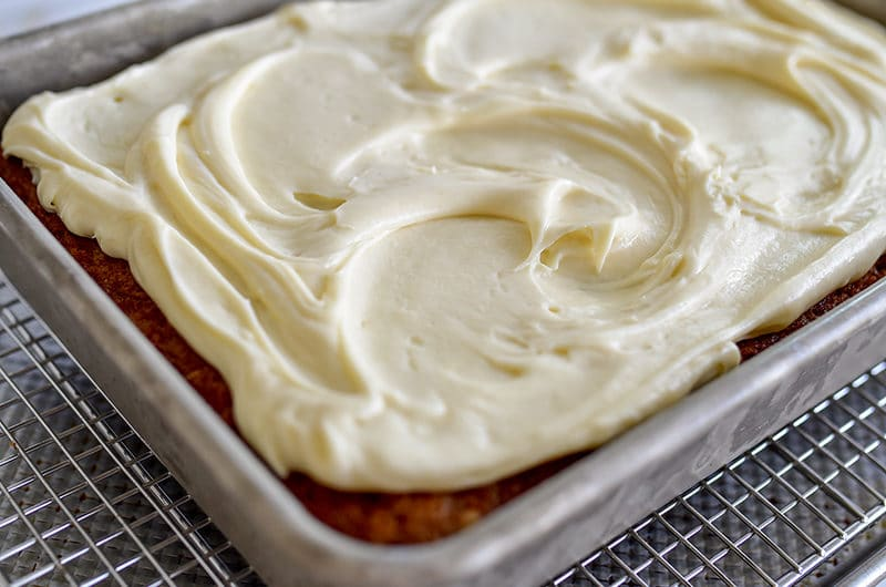 Olive Oil Carrot Cake with Cream Cheese buttercream in a pan