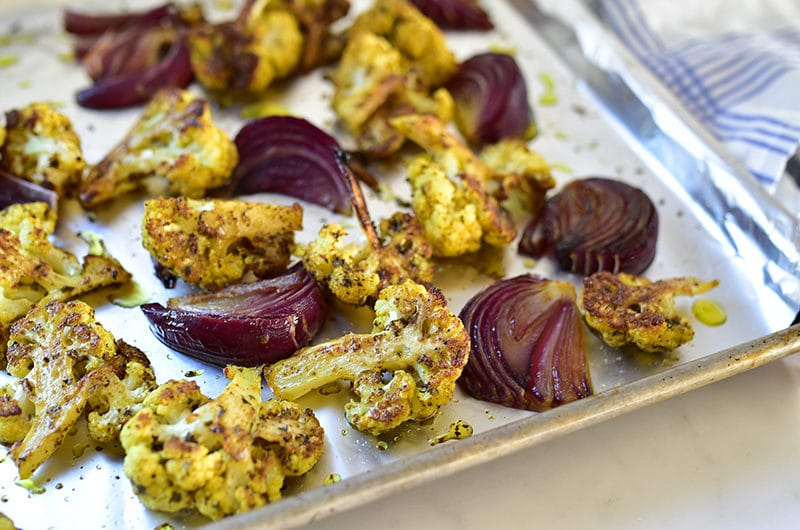 Roasted cauliflower on a sheet pan with foil