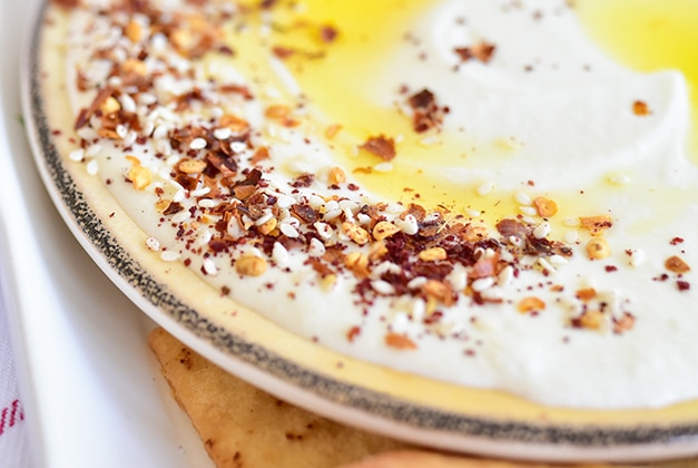 Spices on whipped feta with olive oil