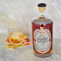 Amaro cocktail on the bar with Amaro Nonno bottle